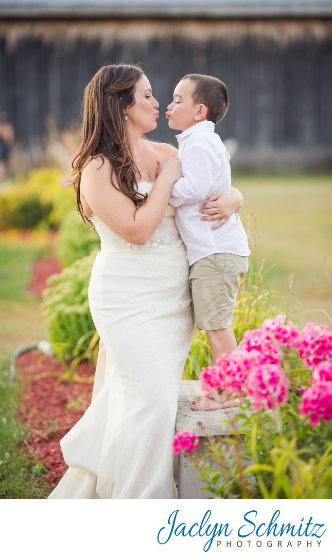 bride and son air kiss in the garden