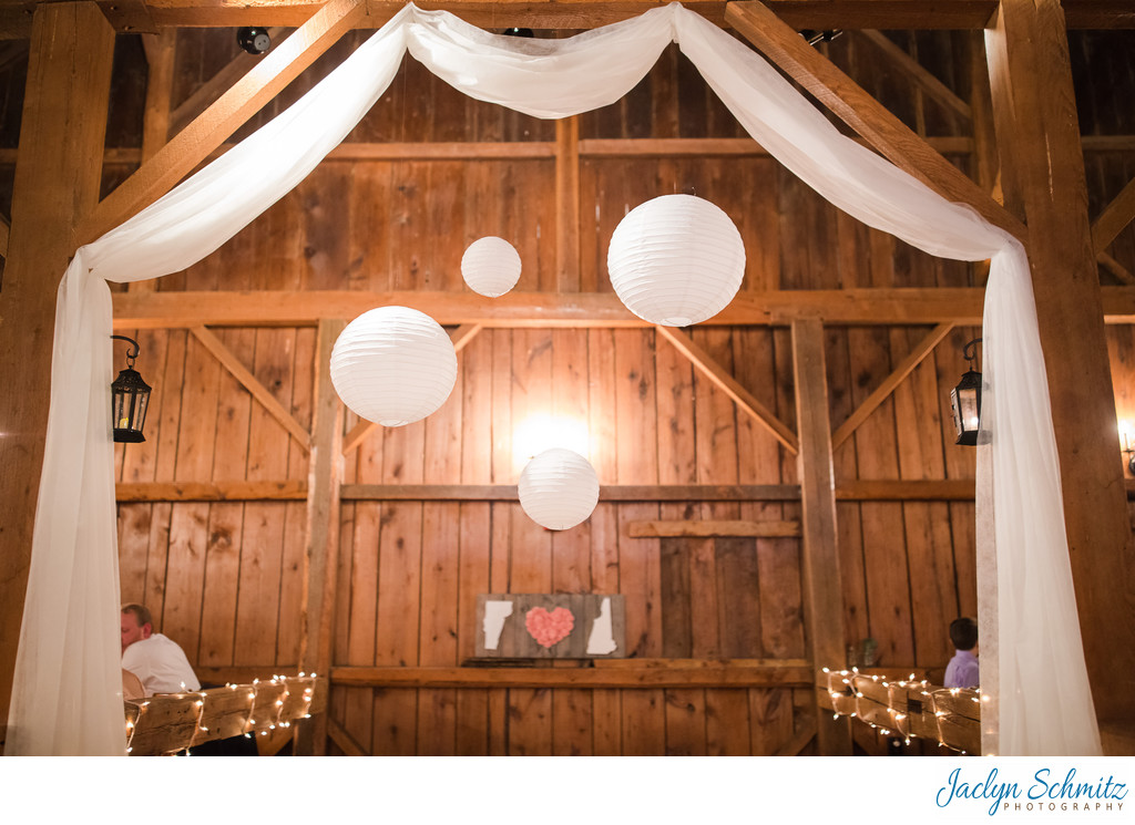 Wedding with white drapery barn rafters