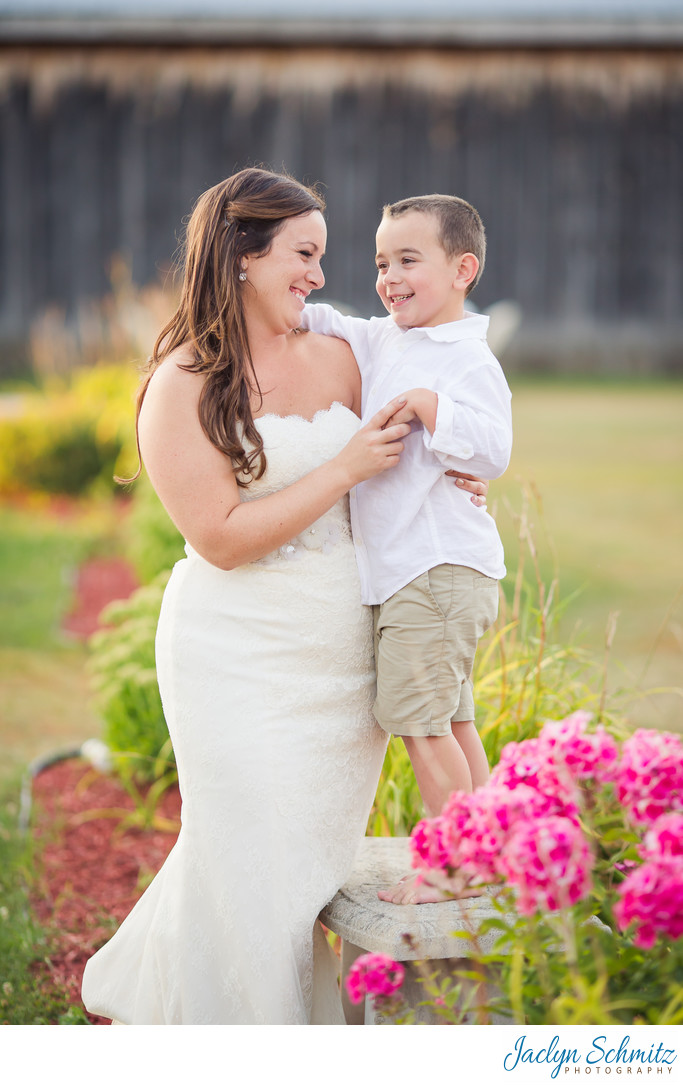 Bride mother son portrait in barn garden