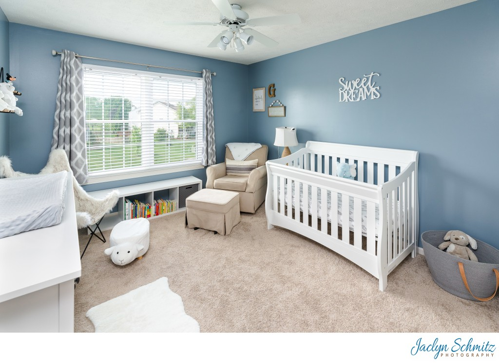 Blue baby nursery real estate photo