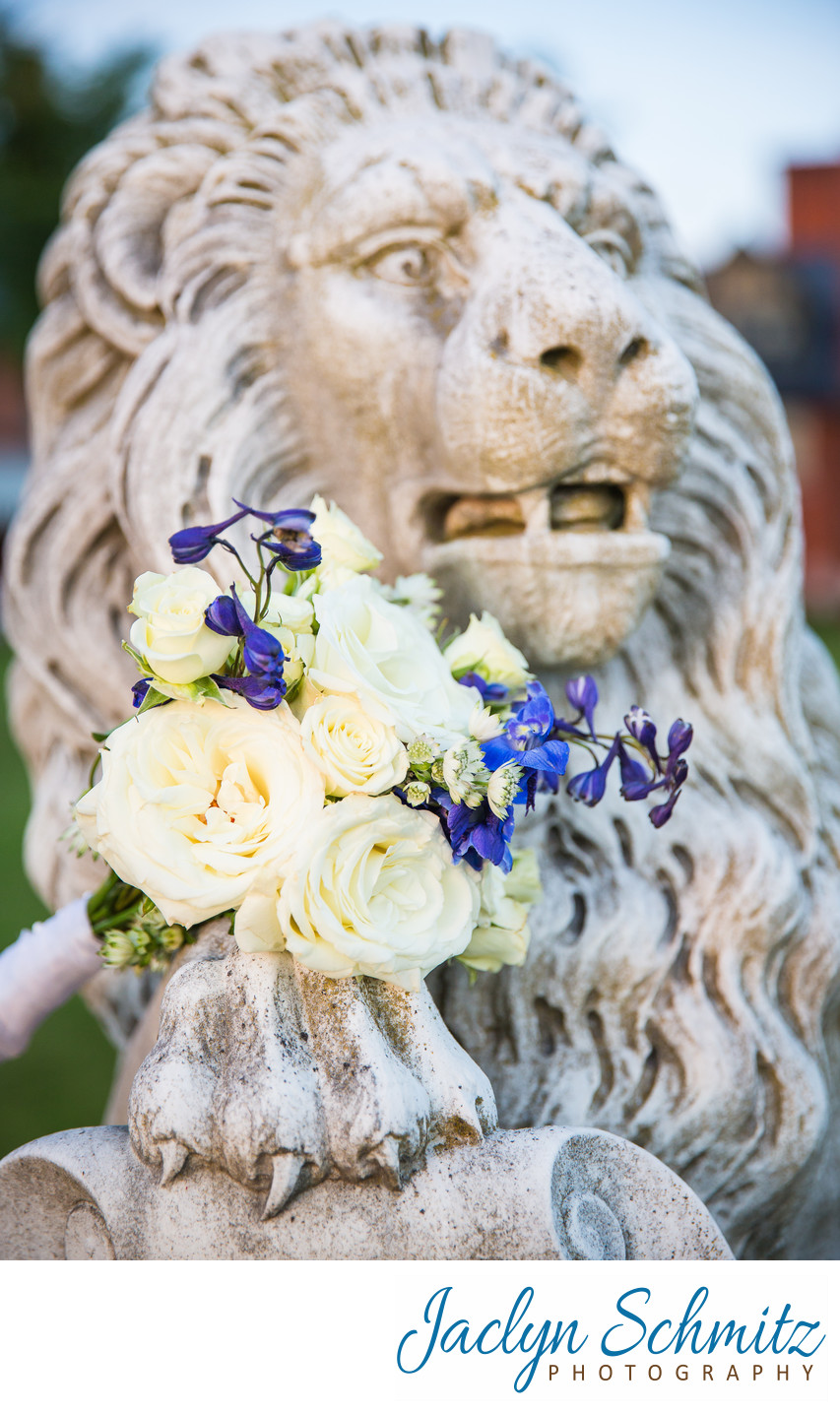 wedding bouquet on stone lion at Shelburne Farms VT