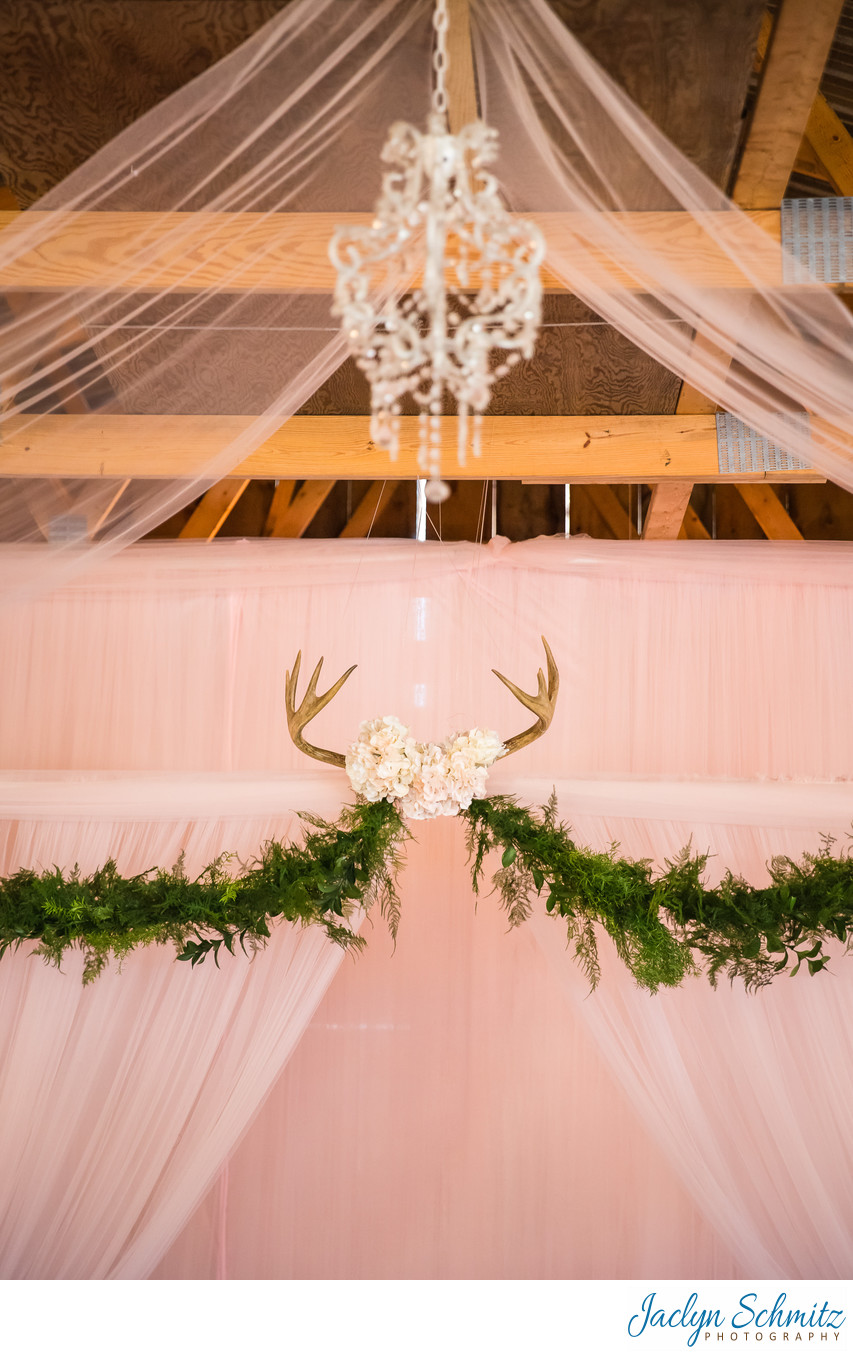 Romantic deer antler wedding ceremony decor