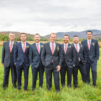 Groomsman in wild grass field