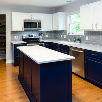Navy kitchen and white quartz counters