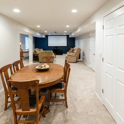 Card table and movie room in basement