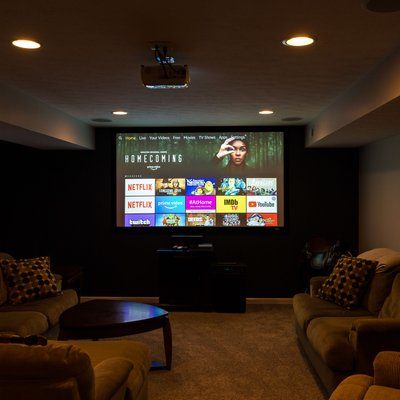 Basement tv room with movie theater lighting