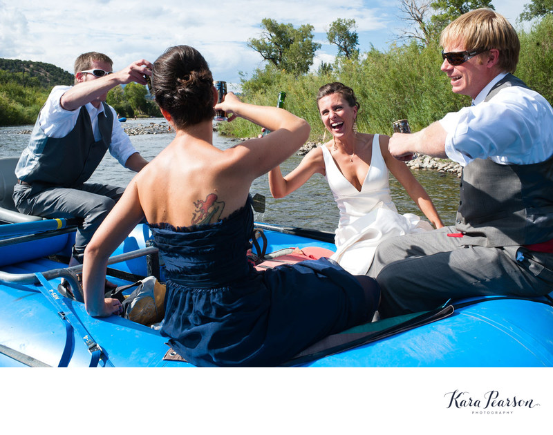 Bride And Groom Rafting Down The River In Salida