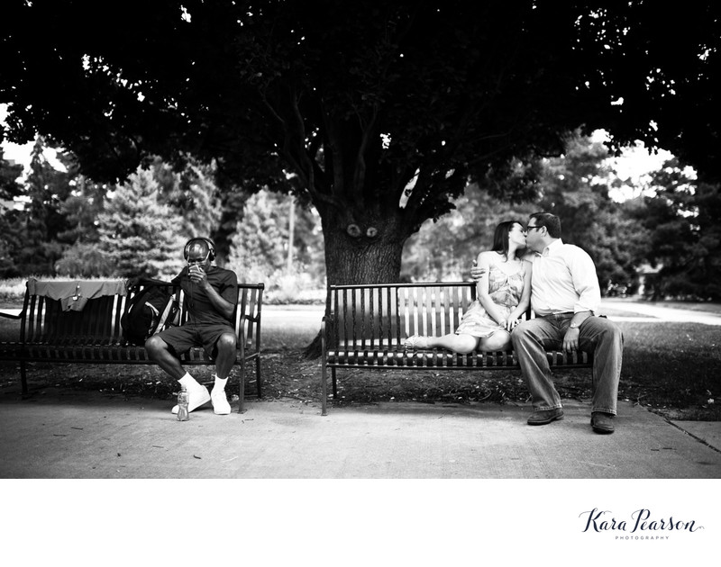Cheeseman Park Engagement Portrait Of Kissing Couple