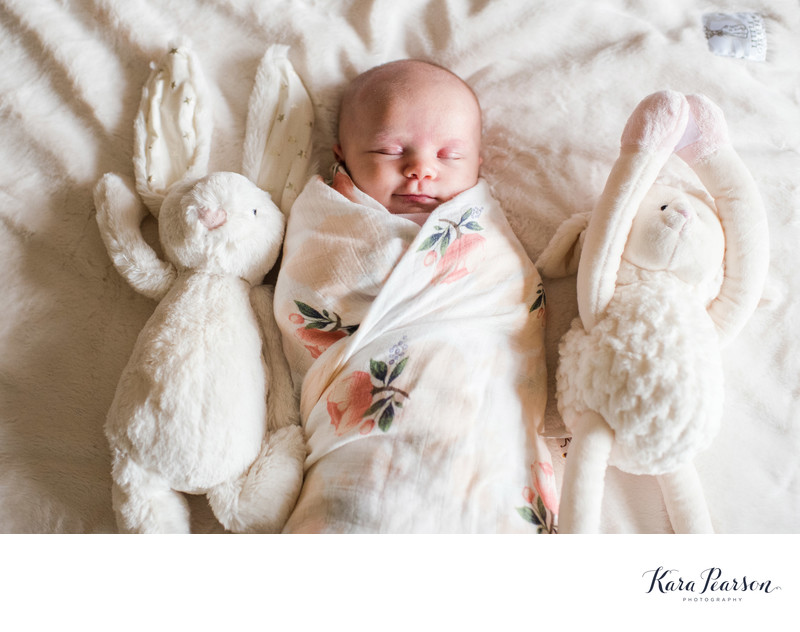 Newborn Baby Girl Poses With Her Stuffed Animals