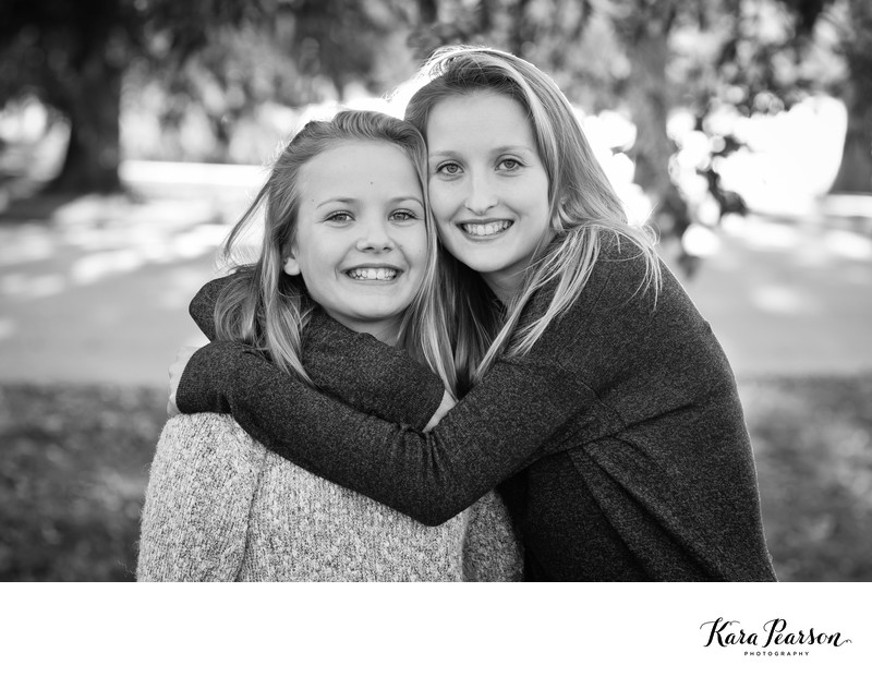 Teen Sisters Portrait At City Park