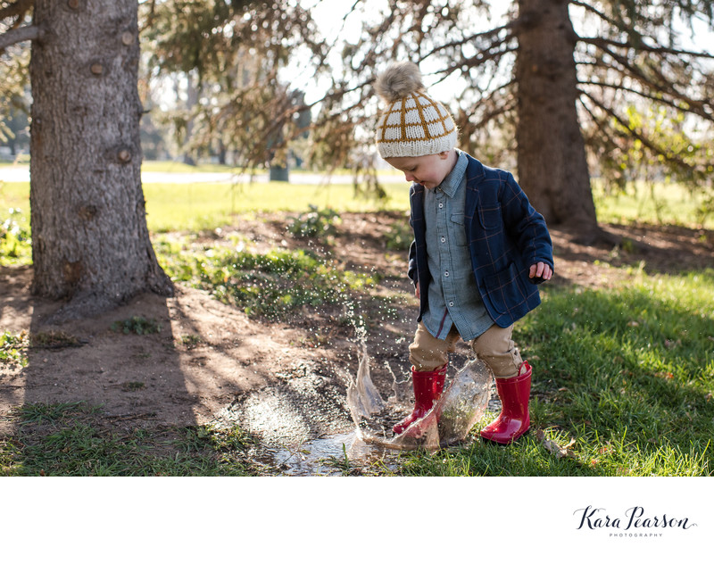 Fun Family Portraits With Kid Jumping In Puddles