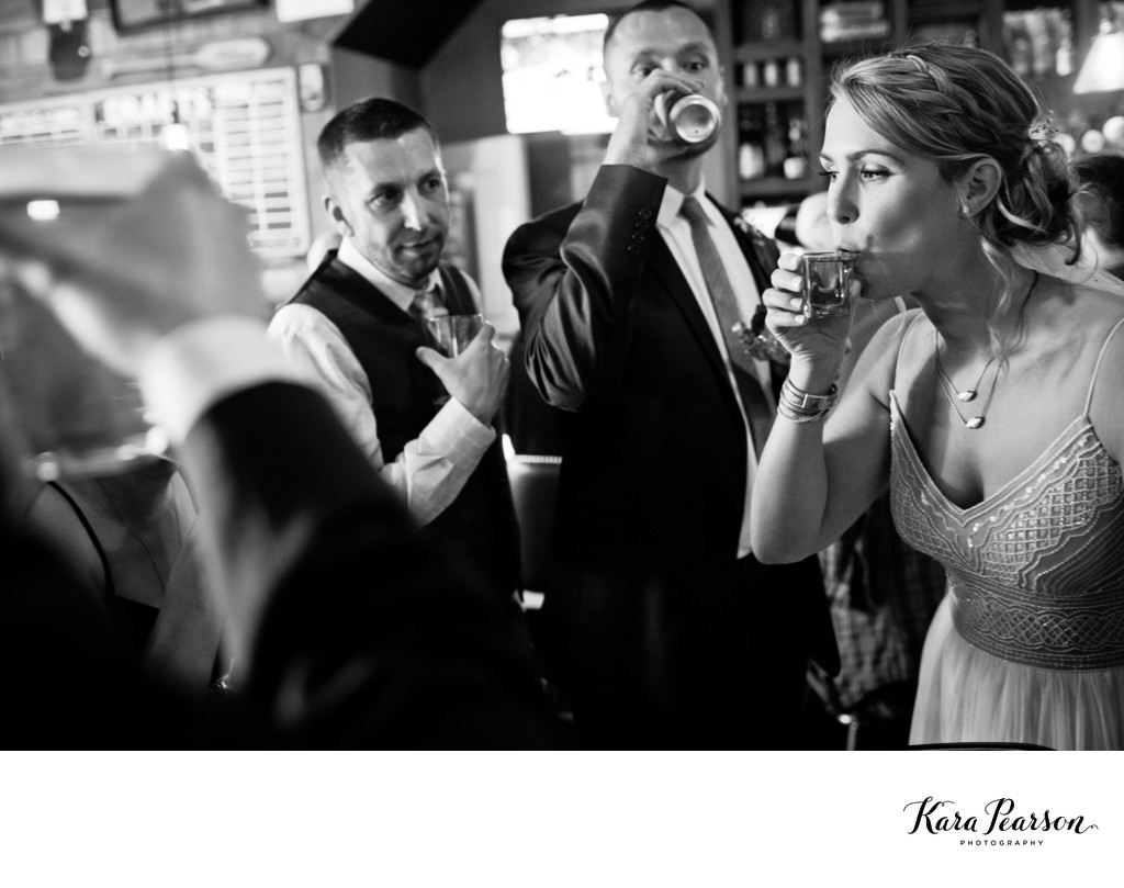 Bride Takes A Shot At A Bar