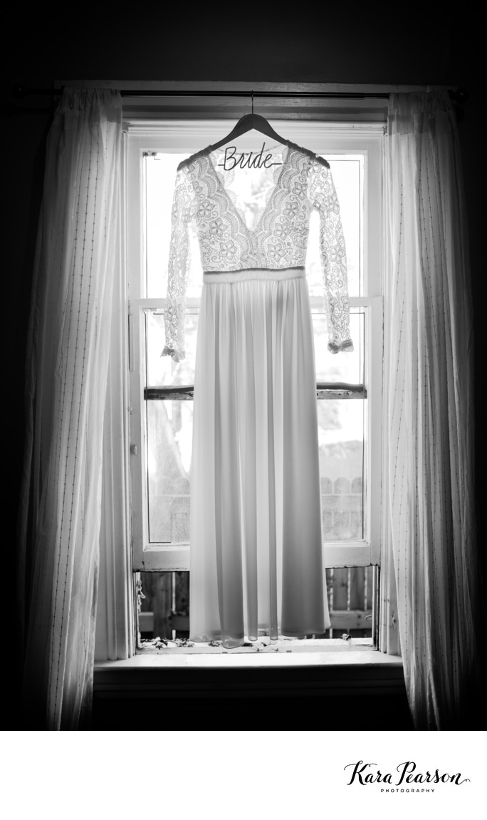 Wedding Dress Hangs In Window