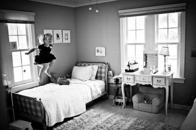 Little Girl Jumping On Bed In Chicago