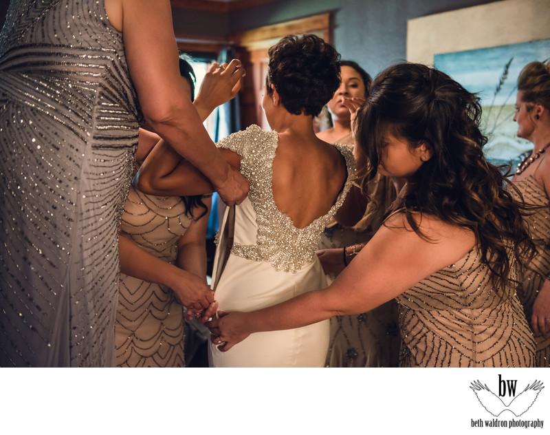 so many women helping the bride get ready