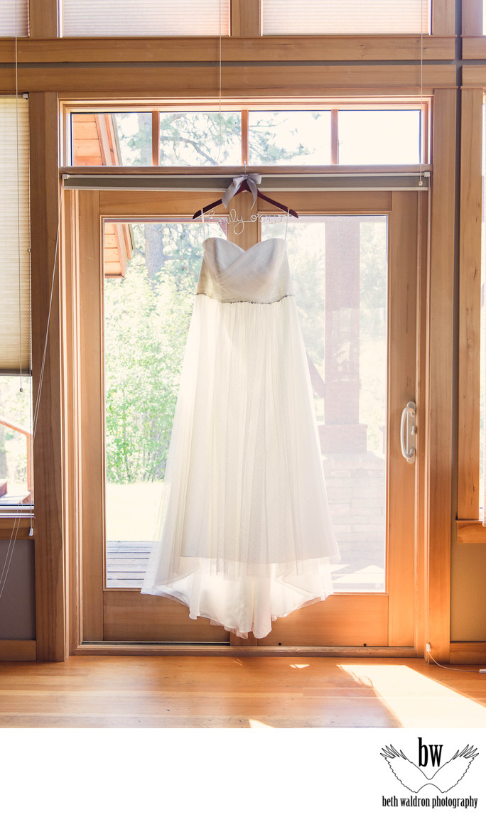Wedding dress in sunlit window