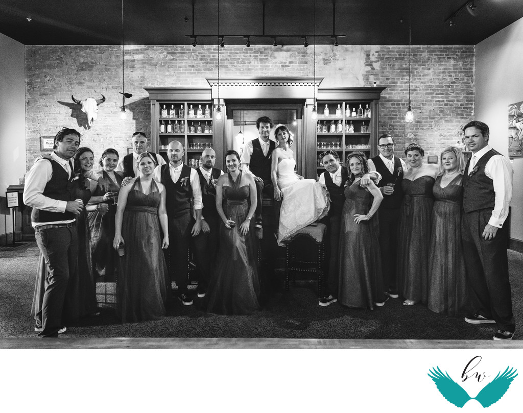 Downtown distillery bar wedding party photo
