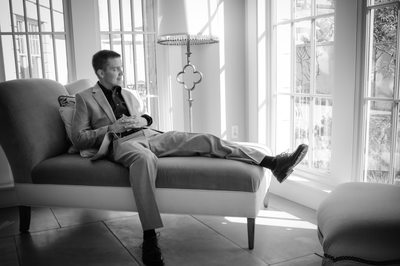 Groom lounging in the sun room of Hotel Parq Central
