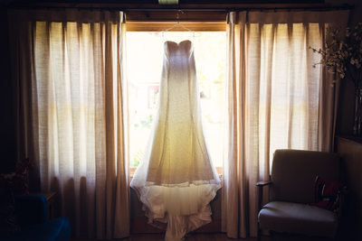 Wedding dress in window - albuquerque wedding photographer