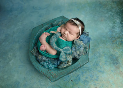 newborn girl with mermaid