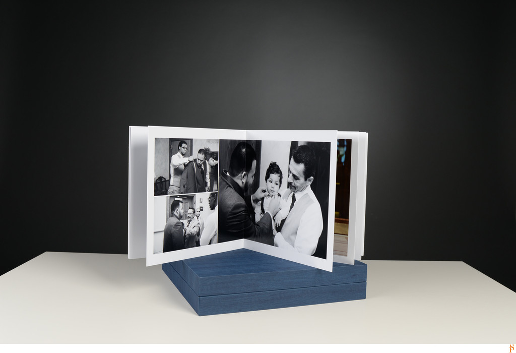 BLACK AND WHITE PHOTOGRAPHS IN A WEDDING ALBUM WITH A BLUE BOX