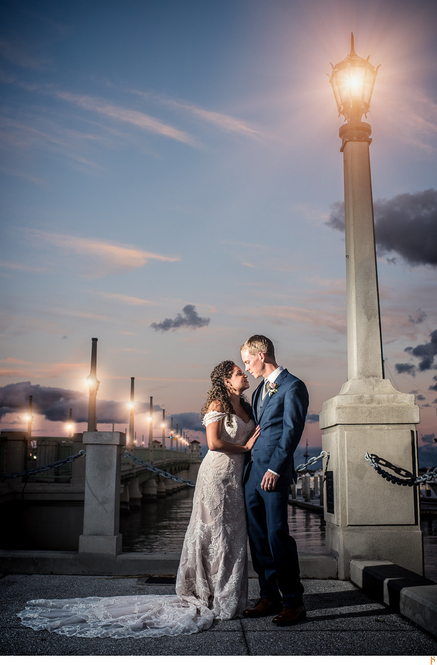 Bride and groom on the Bridge of Lions at sunset in st Augustine