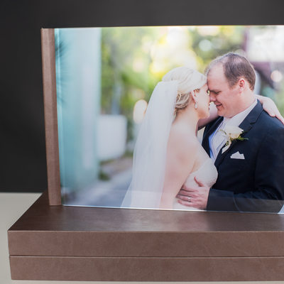 WEDDING ALBUM WITH A PICTURE ON THE COVER AND A BOX