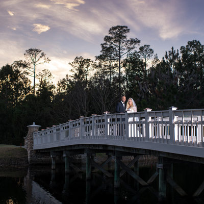 Bride and groom at sunset on a bridge in Nocatee St johns