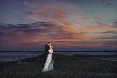 COUPLE AT SUNSET AT RIBAULT CLUB WITH PURPLE SKY