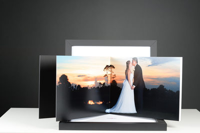 SUNSET BRIDE AND GROOM PHOTO IN A WEDDING ALBUM WITH A BACK BOX