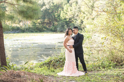 LONG PINK DRESS AND SUIT FOR ENGAGEMENT PHOTOS IN A PARK