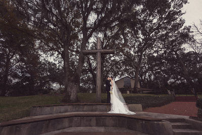 Bride and Groom with the cross