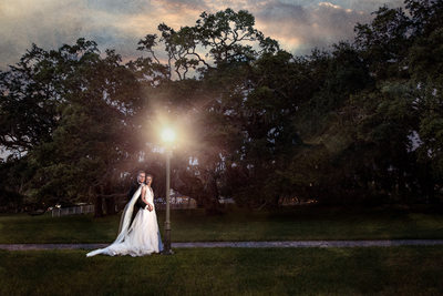 Portrait of the bride and groom at sunset with a light