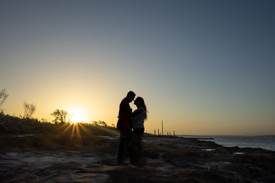 Silhouette at sunset is a gorgeous photograph for couple