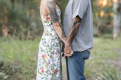 We love how her dress shows her tattoos for their engagement photos.