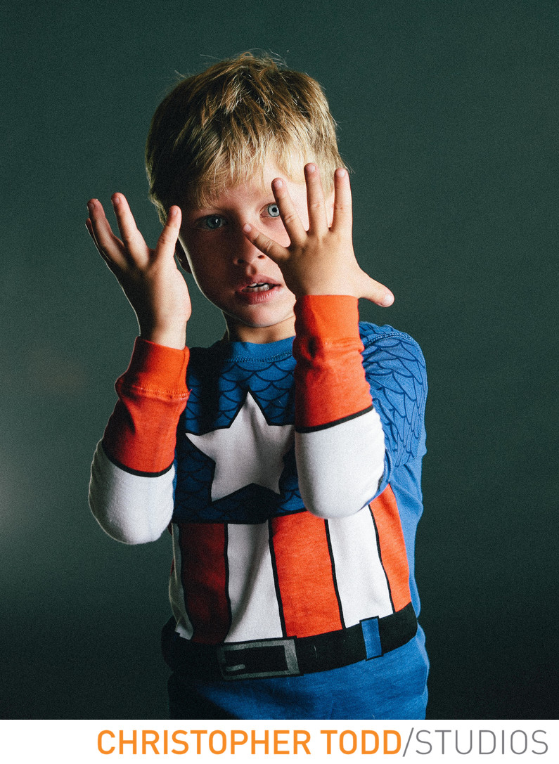 Boy in Superhero Pajamas