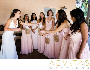 Bride Gives Gifts To Bridesmaids On Wedding Day