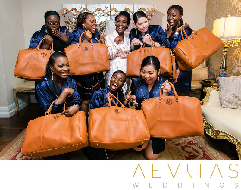 Bridesmaids with leather bag gifts on wedding day