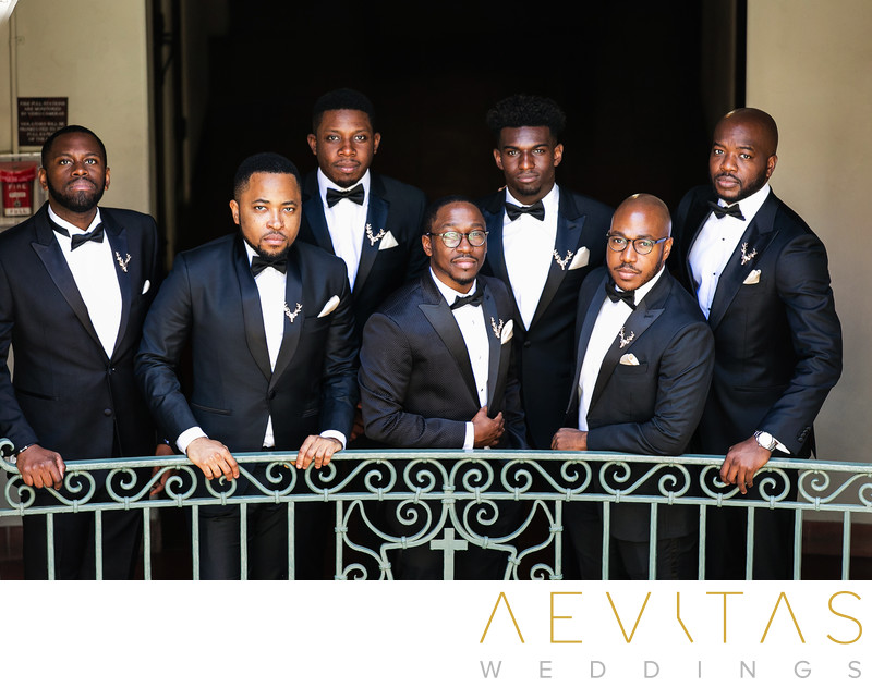 Groom and groomsmen portrait on wrought iron balcony