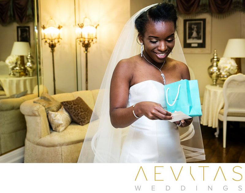 Bride opening Tiffany Co. gift on wedding day