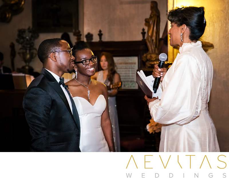 Couple and celebrant at Mission Inn wedding ceremony
