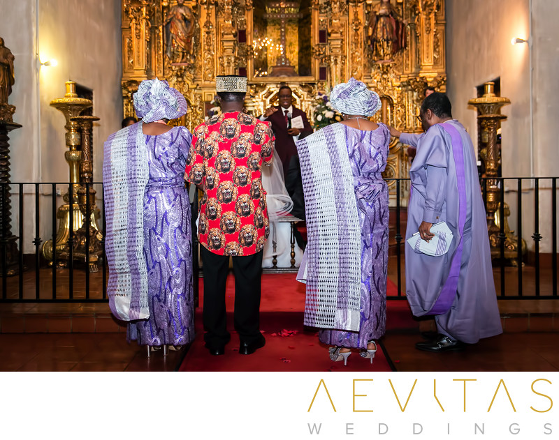 Parents pray at gilded altar during Nigerian wedding