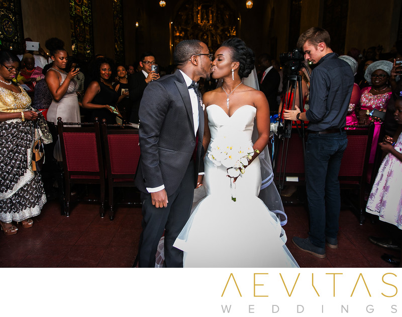 Couple kiss by Mission Inn Hotel wedding photographer
