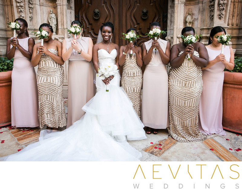 Playful bridal party portrait at Mission Inn Hotel