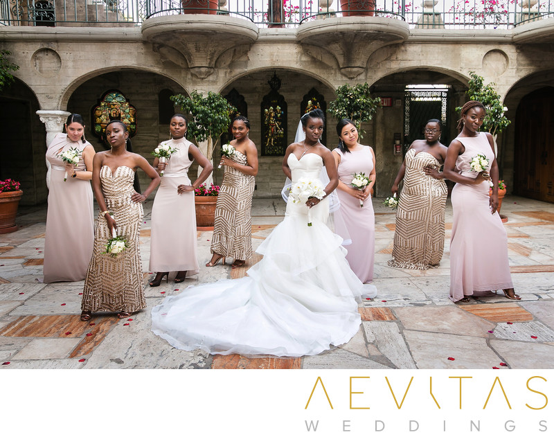 Creative bridal party portrait in Mission Inn courtyard