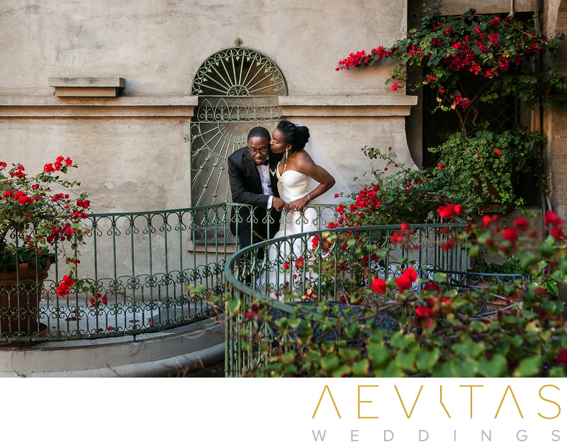 Romantic couple portrait on Mission Inn Hotel balcony