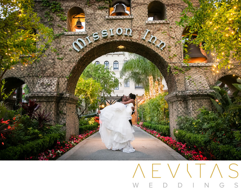 Romantic couple portrait at Mission Inn Hotel entrance