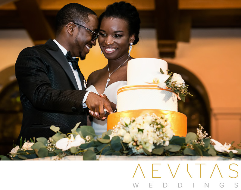 Intimate couple moment during cake cutting