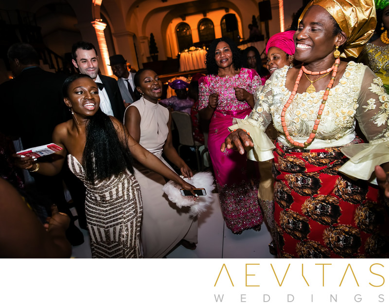 Bridesmaid and mom dancing at Nigerian wedding