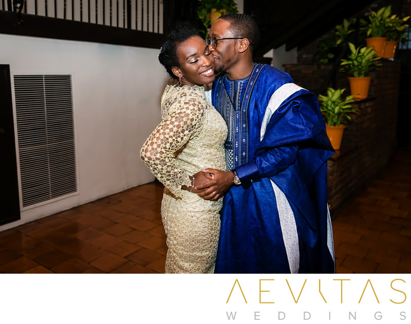 Candid couple kiss at Nigerian wedding reception